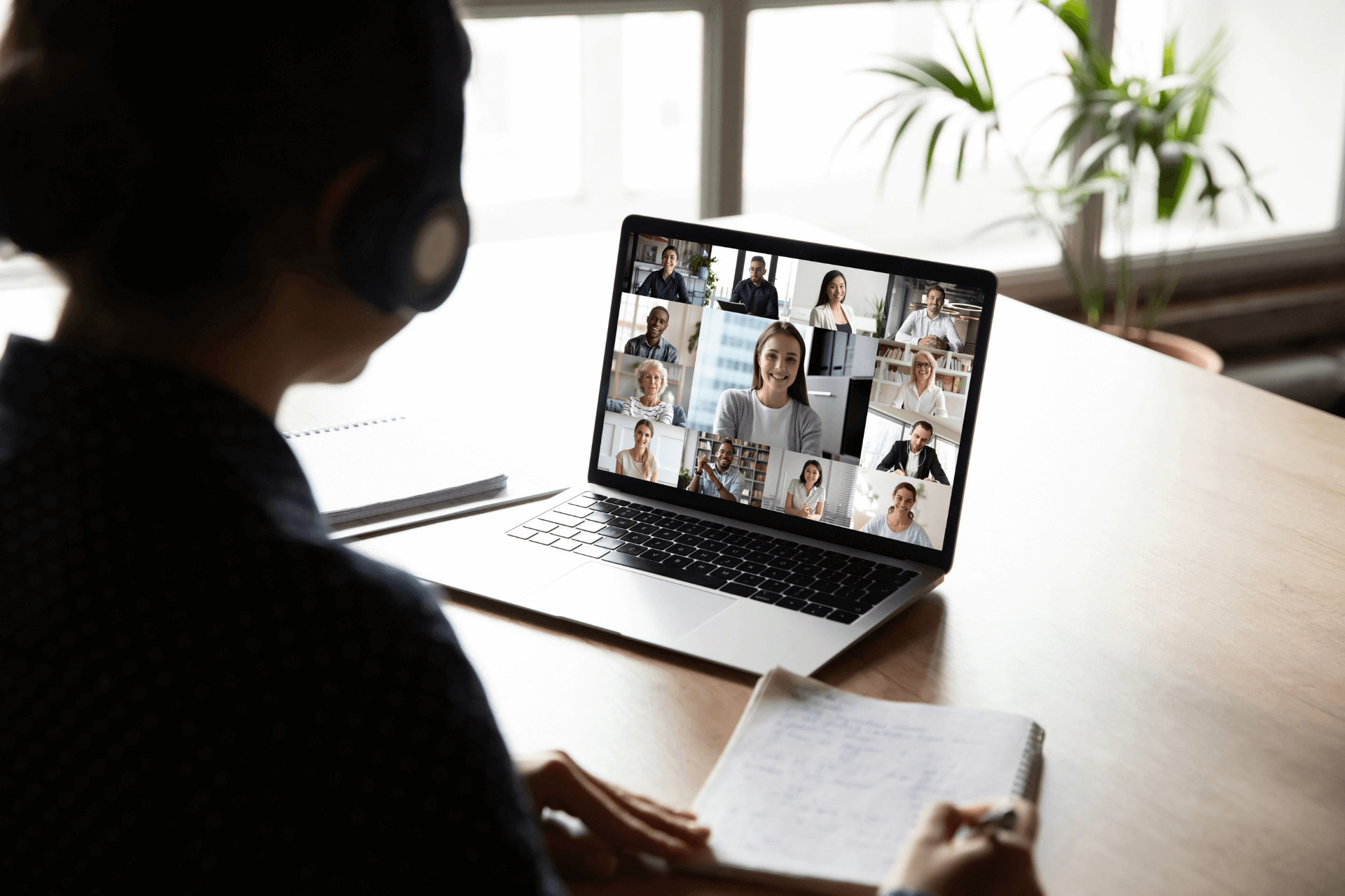 A woman is part of a virtual group call