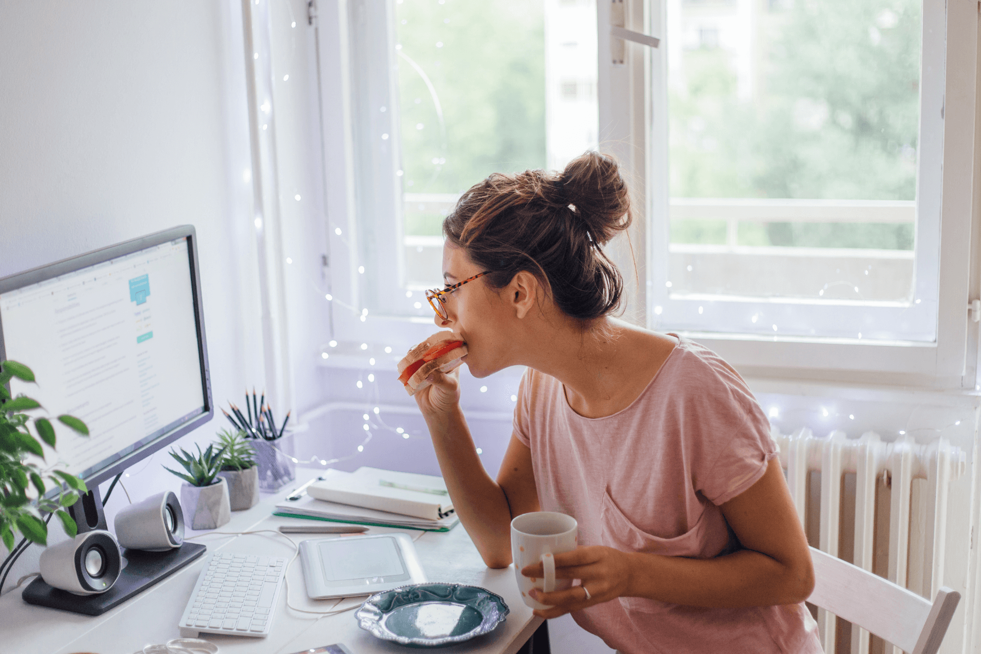 A woman works from home while eating