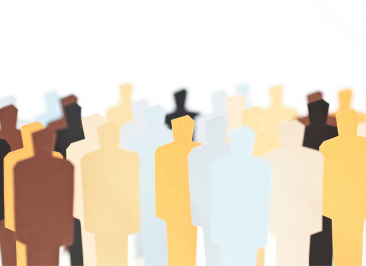 paper cutouts shaped like humans in all shades and colours